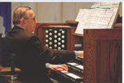 David Cameron playing at the 1996 console of the organ of Chalmers United Church, Kingston, Ontario.